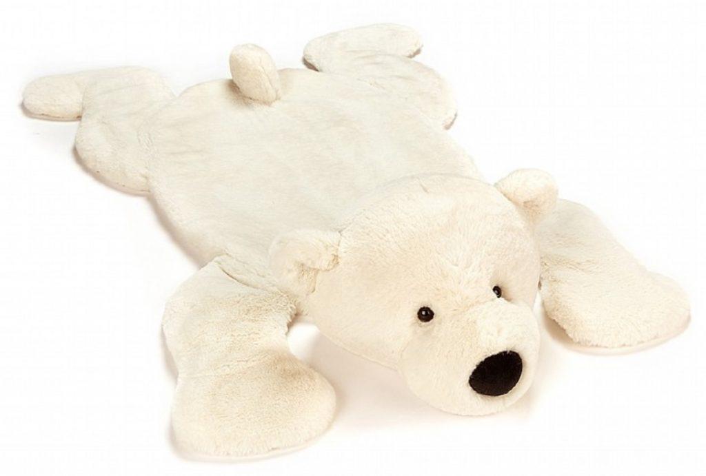 Isbjörn i form av en lekmatta från Jellycat