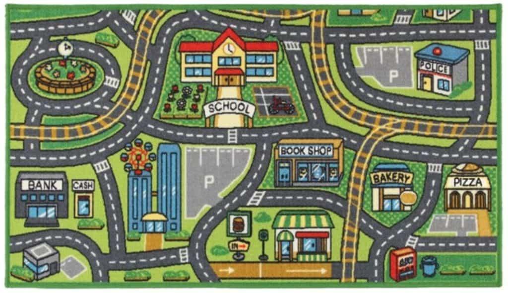 Lekmatta med bild av stad med många byggnader och vägar.